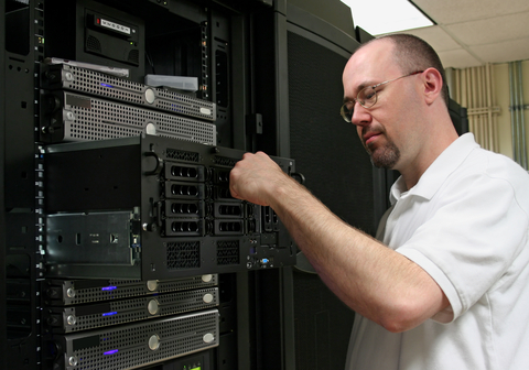 A Technician inspects a raid array