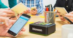Black Klaxoon box is shown on table at meeting setting